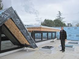 owner bryan mekechuk stands proudly on his new roof which consists