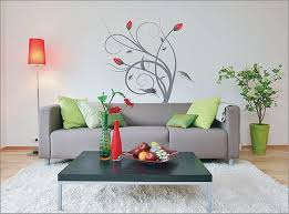 brilliant wall painting ideas in red using keyboard mural for captivating sitting area with grey sofa and green cushions facing simple table on white caret rug ideas