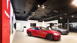 tesla dealership tesla u0027s first queensland store is now open gizmodo australia
