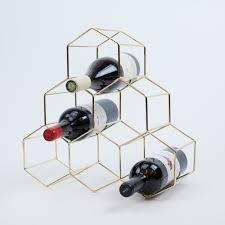 mid century modern gold metal wine rack the vinepair store