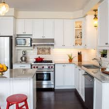 how to make cabinets appear taller how to fix kitchen cabinet open soffits