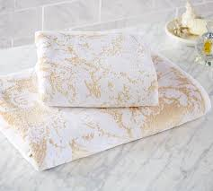 cool white and gold bath towels in white countertop used granite