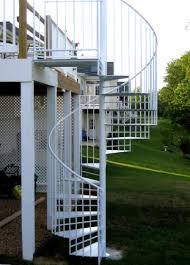 bright white painted outdoor spiral staircase made of metal to