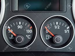 car dashboard temperature and fuel gauge from a car dashboard stock photo