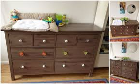 White Wood Changing Table White Grey Pad Changing Table Topper Above Brown Wooden Dresser
