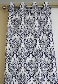 pair of grommet top curtains in navy blue and white slub embrace
