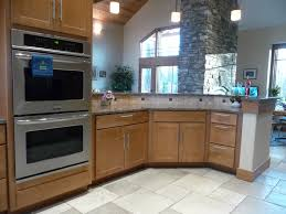 does your dream kitchen include a wall oven hex kitchen peninsula in maple shaker cabinets adjacent to double wall ovens