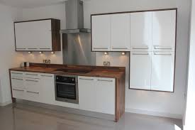 White On White Kitchen Designs White Gloss Kitchen With Wood Wrap Around Kitchen Design