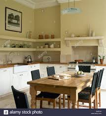 Pine Table Pine Table And Chairs With Black Seats And Backs In Cream Kitchen