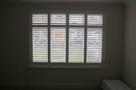 bespoke wooden shutters fitted to bay windows in selsdon the