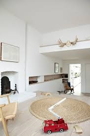 round rugs for living room white painted brick living room scandinavian with round rug