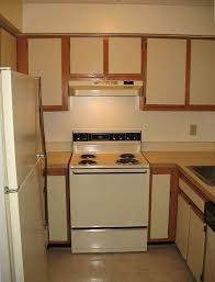 how to paint kitchen cabinets using liquid sandpaper diy painting laminate kitchen cabinets the easy way with
