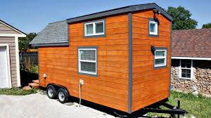 tiny house on wheels redwood exterior siding rustic feel small