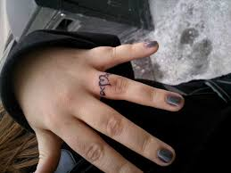 and j word on couple a wedding ring tattoos and j word tattoo on