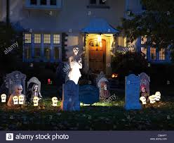 halloween yard lighting spooky halloween decoration cemetery in the front yard of a house