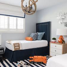blue and orange kid u0027s room boasts pale blue walls lined with tall