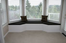 black fabric window seat added by dark brown striped cushions and