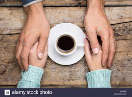 Top Of Coffee Cup Man Holds Woman U0027s Hand Near A Cup Of Coffee Top View Image On