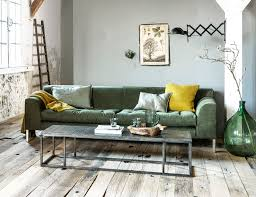 livingroom club industrial living room with pops of green and yellow and a wooden