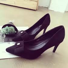yellow high heels with bow is heel