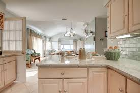 Kitchen Counter Backsplash by Beach House Kitchen With Crema Astoria Granite Countertops And A