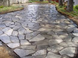 Flagstone Patio Cost Per Square Foot by Nearby Nature Landscaping