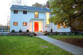 back door entry exterior traditional with red front door wood siding outdoor lighting