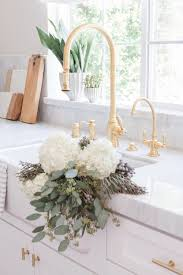 Gold Kitchen Faucet by Pretty Gold And White Kitchen By Nicole Davis Interiors Gold