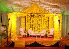 beautiful yellow color mehndi stage flower arrangement guide to