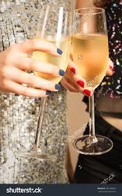 stock photo hands of two girls toasting with champagne at party