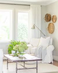 White Slipcovered Sofa by Living Room Update A Burst Of Beautiful