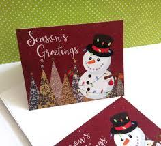 snowman christmas cards with season u0027s greetings phrase