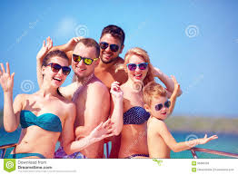 of happy friends family on yacht during summer