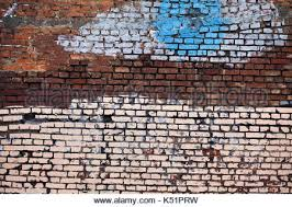 wall painting white red brick wall red paint on tan wall street