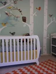 baby nursery with a subtle forest creatures and owl theme diy
