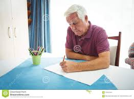 writing white paper portrait of retired man writing on white paper stock photo image portrait of retired man writing on white paper