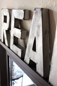 metal wall letters home decor some cardboard letters spray paint and brads and voila sweet
