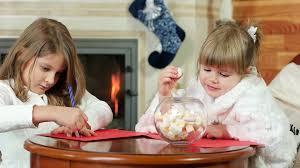 little girls write letters to santa claus closeup portrait sweet