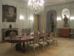 glamorous dining room chandeliers over long wooden oval dining