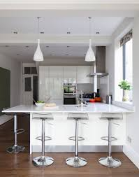 modern white kitchen with hi gloss units and breakfast bar decor
