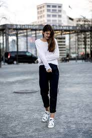 white sweater blue pants and white sneakers white and blue