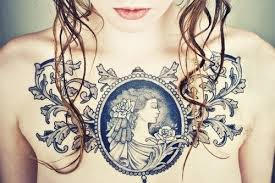cameo brooch womens chest tattoos chest