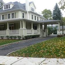 square gray house with porte cochere maple ave grey houses