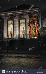 Home Decorated For Christmas by A Rainy Night View Of A Home Decorated For Christmas With Tin