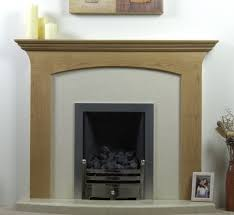 marble firebox fireplace with carved brown wooden mantel shelf