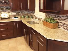 giallo ornamental granite with backsplash crema marfil tile