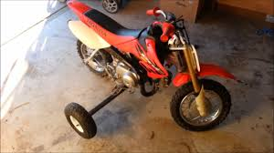wheels motocross bikes diy how to make training wheels for a kids dirtbike youtube