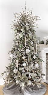 intricate white and silver tree decorations with chritsmas