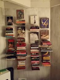 decor umbra conceal floating bookshelves with rustic wall