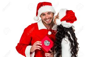 couple with christmas hats holding red gift box on white screen